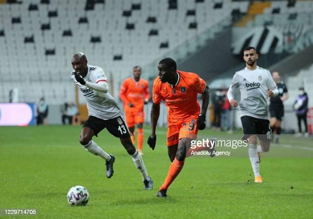 Atiba Hutchinson of Besiktas in action against Demba Ba of Medipol Basaksehir during Turkish Super Lig soccer match between Besiktas and Medipol...