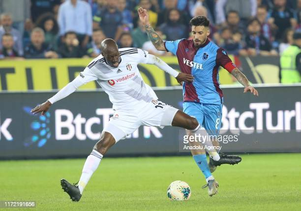 Atiba Hutchinson of Besiktas in action against Jose Sosa of Trabzonspor during the Turkish Super Lig soccer match between Trabzonspor and Besiktas at...