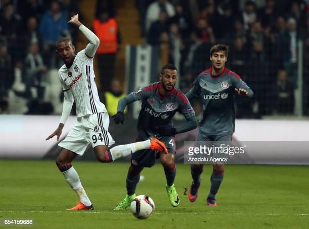 Atiba Hutchinson of Besiktas in action against Karim Ansarifard of Olympiacos during the UEFA Europa League Round 16 secondleg match between Besiktas...