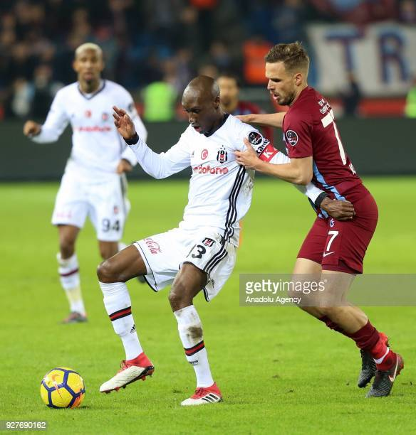 Atiba Hutchinson of Besiktas in action against Novak of Trabzonspor during the Turkish Super Lig soccer match between Trabzonspor and Besiktas at...