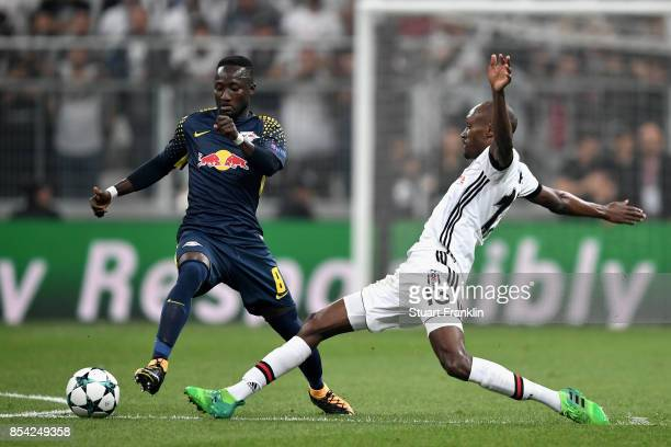 Atiba Hutchinson of Besiktas tackles Naby Keita of RB Leipzigduring the UEFA Champions League Group G match between Besiktas and RB Leipzig at...
