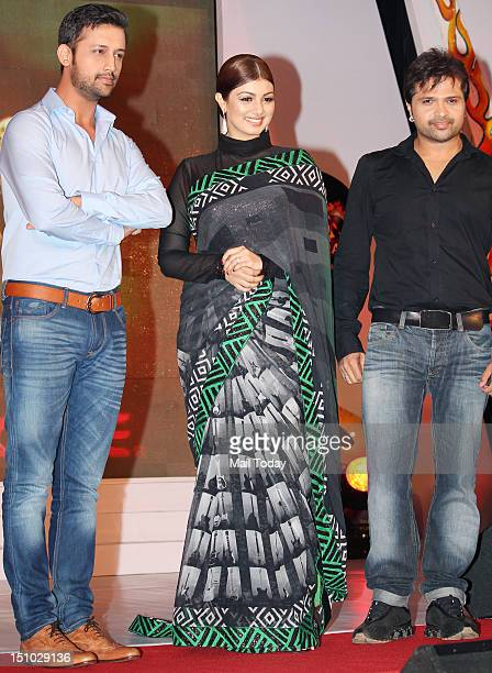 Atif Aslam Ayesha Takia and Himesh Reshammiya during the launch of TV show 'Sur Kshetra' at Taj Lands End in Mumbai on August 30 2012