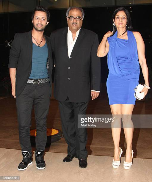 Atif Aslam Boney Kapoor and Sridevi during Farah Khan's house warming bash in Mumbai on December 20 2011
