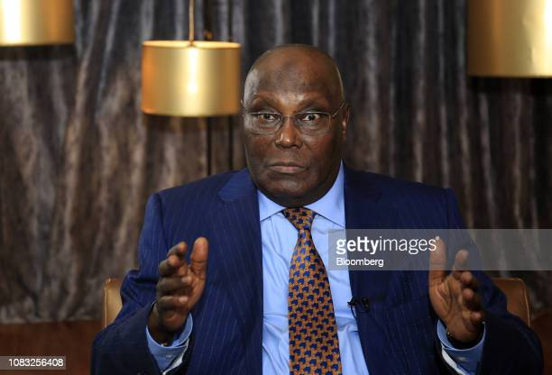 Atiku Abubakar Nigeria's main opposition presidential candidate gestures as he speaks during a Bloomberg Television interview in Lagos Nigeria on...