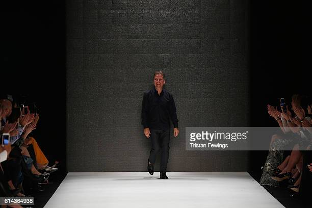 Atil Kutoglu is applauded on the runway at the Atil Kutoglu show during MercedesBenz Fashion Week Istanbul at Zorlu Center on October 13 2016 in...