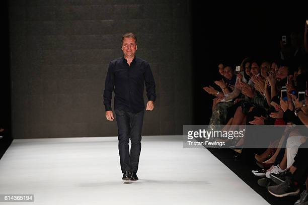 Atil Kutoglu is applauded on the runway at the Atil Kutoglu show during Mercedes-Benz Fashion Week Istanbul at Zorlu Center on October 13, 2016 in...