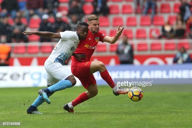 Atila Turan of Kayserispor in action against Fabian Castillo of Trabzonspor during Turkish Super Lig soccer match between Kayserispor and Trabzonspor...