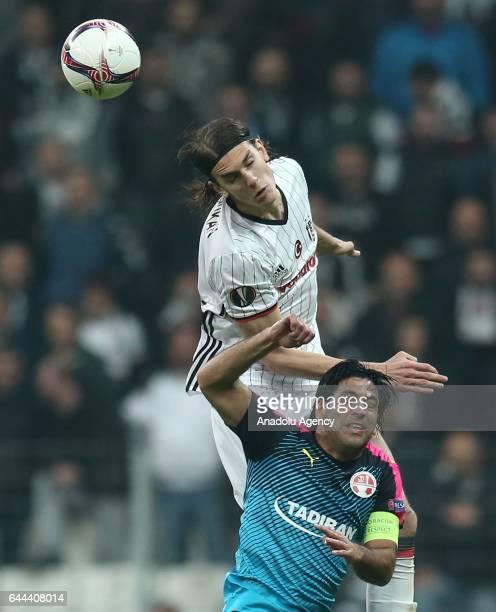 Atinc Nukan of Besiktas in action against Elyaniv Barda of Hapoel BeerSheva during UEFA Europa League Round of 32 match between Besiktas and Hapoel...