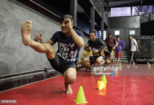 Atiq Khairi a young MMA fighter trains at the Snow Leopard Fighting Championship gym on May 13 in Kabul Sports like Cricket and soccer are well known...