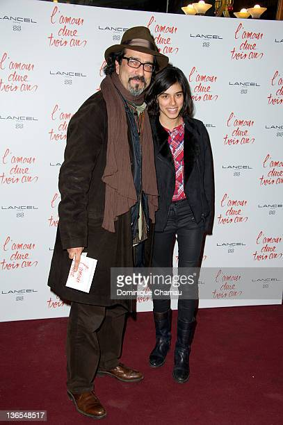 Atiq Rahimi and his daughter Alice attend 'L'Amour Dure Trois Ans' at Le Grand Rex on January 7 2012 in Paris France