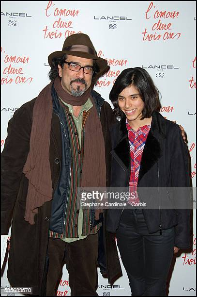 Atiq Rahimi and his daughter Alice attend the premiere of 'L'Amour Dure Trois Ans' at Le Grand Rex in Paris