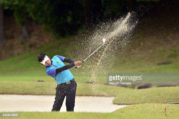 Atiruj Winalcharoenchai of Thailand hits from a bunker on the 18th hole during the third round of 2016 TOYOTA Junior Golf World Cup at Ishino Course...
