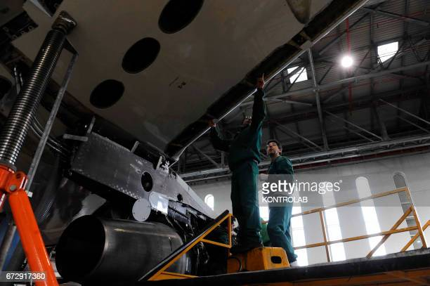 Atitech workers, work at a wing of one Alitalia airplane in Atitech Factory, in the airport of Capodichino in Naples.