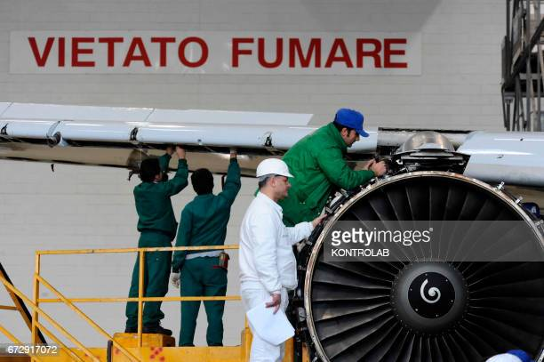 Atitech workers, work on a motor of one Alitalia airplane in Atitech Factory, in the airport of Capodichino in Naples.
