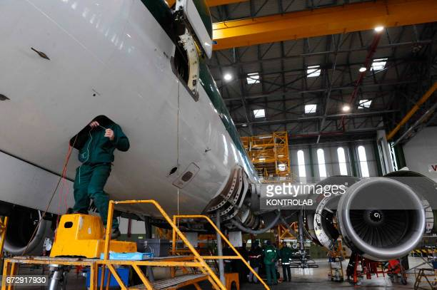 Atitech workers, work on Alitalia airplane in Atitech Factory, in the airport of Capodichino in Naples.