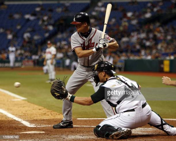 Atlanta Brave Chipper Jones watches strike three as Tampa Bay's Toby Hall receives the pitch in Friday night's action at Tropicana Field in St...