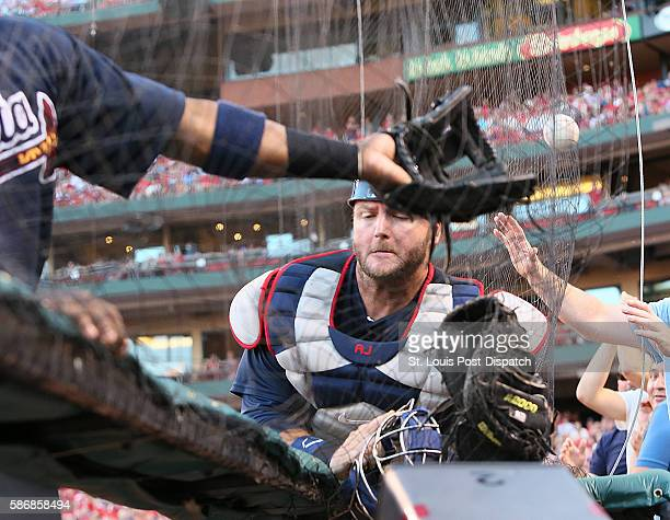 Atlanta Braves catcher AJ Pierzynski and third baseman Adonis Garcia converge but neither are able to catch a foul ball off the bat of the St Louis...