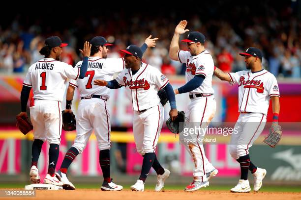 Atlanta Braves celebrate their 3-0 win over the Milwaukee Brewers in game 3 of the National League Division Series at Truist Park on October 11, 2021...