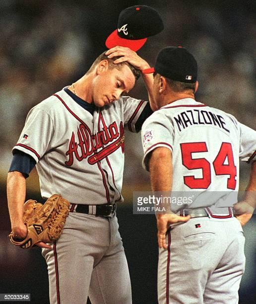 Atlanta Braves coach Leo Mazzone comes to the mound to talk with pitcher Tom Glavine after the starter walked Arizona Diamondbacks' Travis Lee in the...