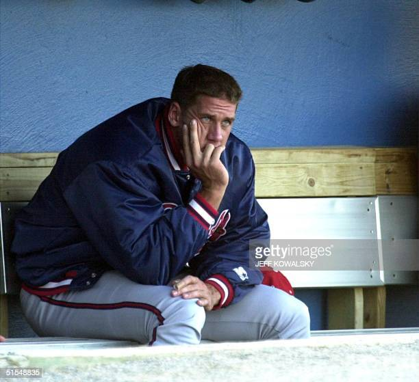 Atlanta Braves' controversial pitcher John Rocker who has been assigned to their minor league Richmond Braves farm team sits in the dugout during...
