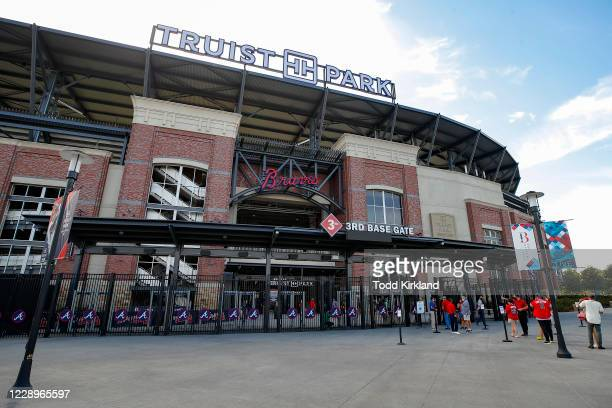 Atlanta Braves fans enter Truist Park to watch Game Three of the National League Division Series between the Miami Marlins and Atlanta Braves at...