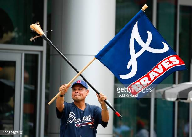 Atlanta Braves fans react at The Battery outside of Truist Park after the Atlanta Braves sweep the Miami Marlins in Game Three of the National League...