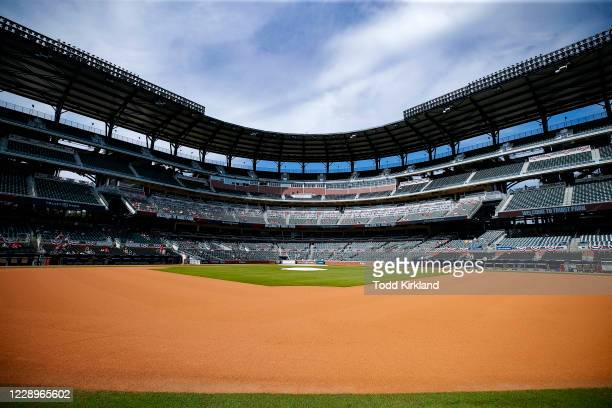 Atlanta Braves fans watch Game Three of the National League Division Series between the Miami Marlins and Atlanta Braves at Truist Park on October 8,...