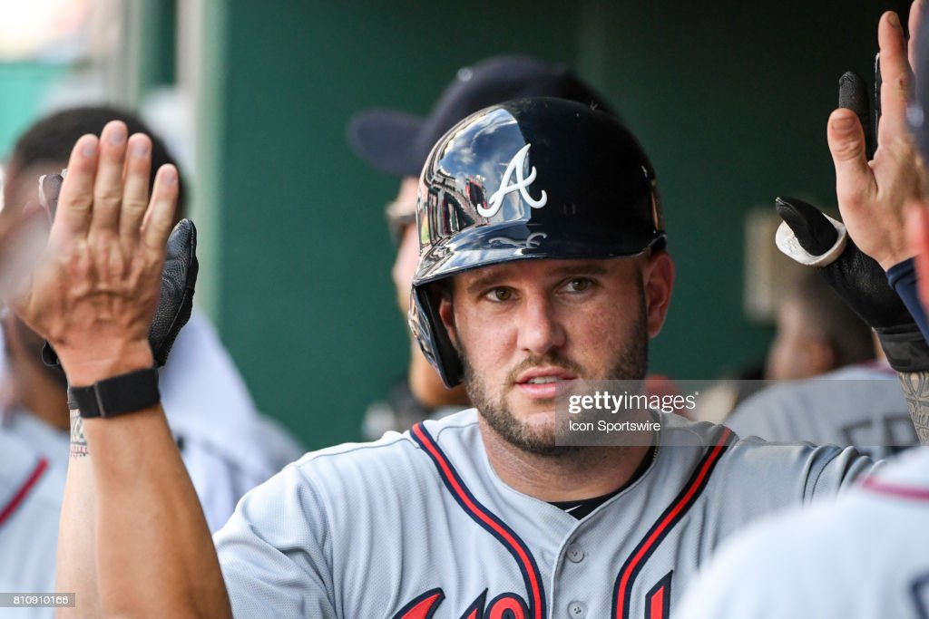 Atlanta Braves first baseman Matt Adams (18) is congratulated in the dugout after scoring during an MLB game between the Atlanta Braves and the Washington Nationals on July 8, 2017, at Nationals Park in Washington, D.C.