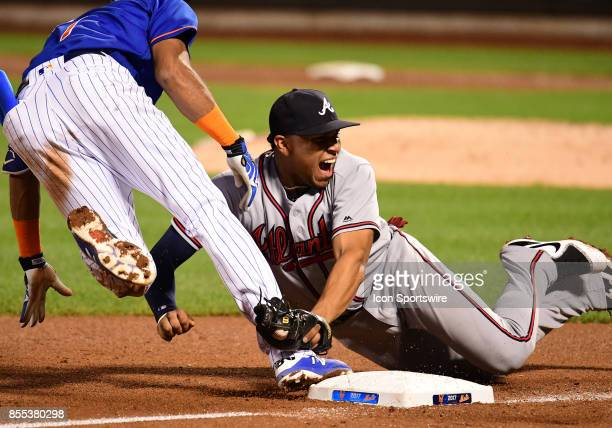 Atlanta Braves Infield Johan Camargo reacts to New York Mets Infield Amed Rosario being called safe at 3rd during a MLB game between the New York...