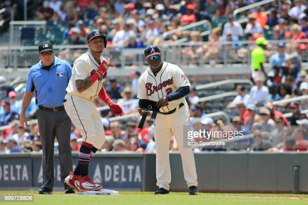Atlanta Braves Infielder Johan Camargo is safe on first base after hitting an infield single during the MLB game between the Arizona Diamondbacks and...