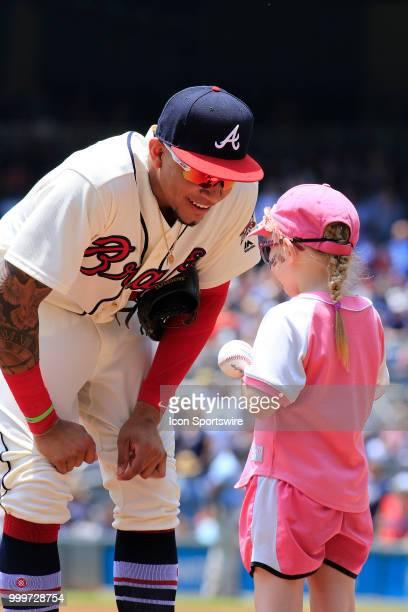 Atlanta Braves Infielder Johan Camargo talks to a young fan prior to the MLB game between the Arizona Diamondbacks and the Atlanta Braves on July 15...