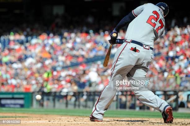 Atlanta Braves left fielder Matt Kemp hits and RBI single in the third inning during an MLB game between the Atlanta Braves and the Washington...