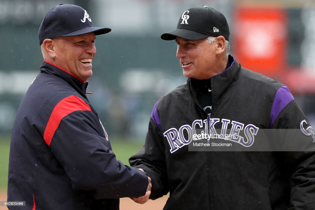 Atlanta Braves Manager Brian Snitker shakes hands with Colorado Rockies Manager Bud Black at home plate before their game at Coors Field on April 6, 2018 in Denver, Colorado.