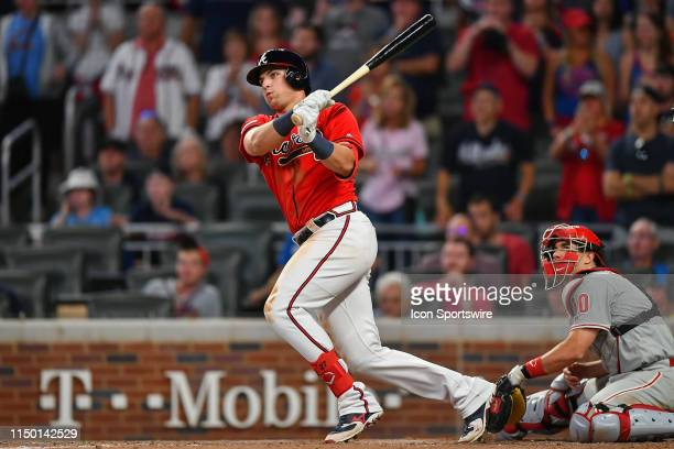 Atlanta Braves outfielder Austin Riley hits a double and drives in a run in the 9th inning during the game between the Atlanta Braves and the...