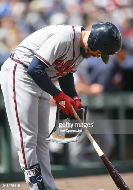 Atlanta Braves Outfielder Ender Inciarte applies pine tar prior to an atbat during a regular season MLB game between the Colorado Rockies and the...