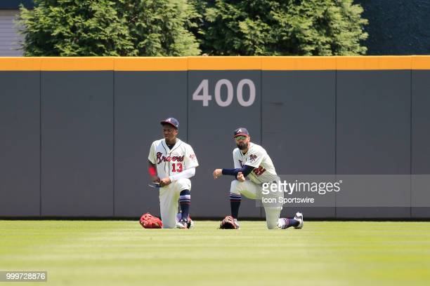 Atlanta Braves Outfielder Ronald Acuna Jr and Atlanta Braves All Star right fielder Nick Markakis wait for the grounds crew to repair the pitching...