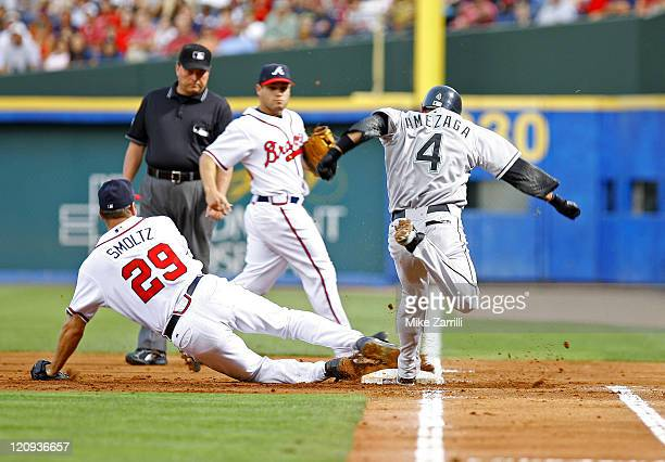 Atlanta Braves P John Smoltz makes the defensive play of the game to get the out at 1B against Marlins SS Alefredo Amezaga during the game between...