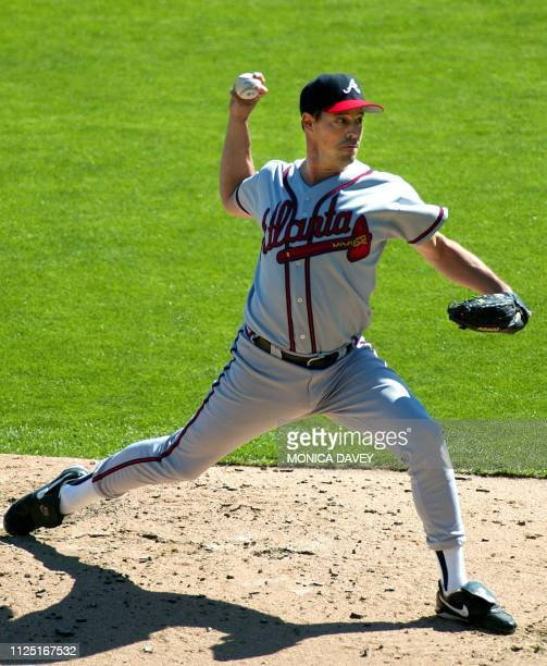Atlanta Braves' pitcher Greg Maddux winds up for a pitch against the San Francisco Giants during game three of the National League Division Series at...