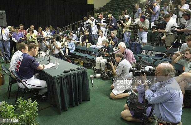 Atlanta Braves pitcher John Rocker reads a statement during a news conference at Walt Disney's Wide World of Sports Complex in Lake Buena Vista...
