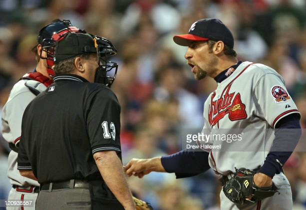 Atlanta Braves pitcher John Smoltz argues with home plate umpire Tim Timmons after hitting Phillies batter Jimmy Rollins Wednesday May 3 2006 at...