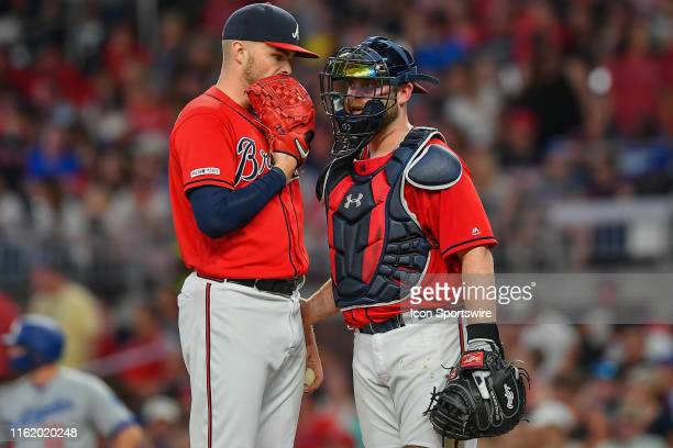 Atlanta Braves pitcher Sean Newcomb talks things over with catcher Brian McCann during the MLB game between the Los Angeles Dodgers and the Atlanta...
