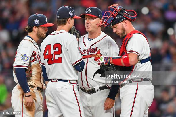 Atlanta Braves pitching coach Marty Reed talks with Max Fried Dansby Swanson and catcher Tyler Flowers during the game between the Atlanta Braves and...