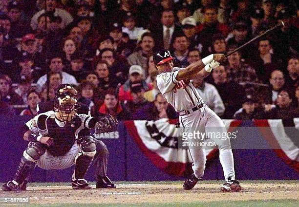 Atlanta Braves player Andruw Jones connects for a tworun home run in the second inning of Game One of the World Series with the New York Yankees at...