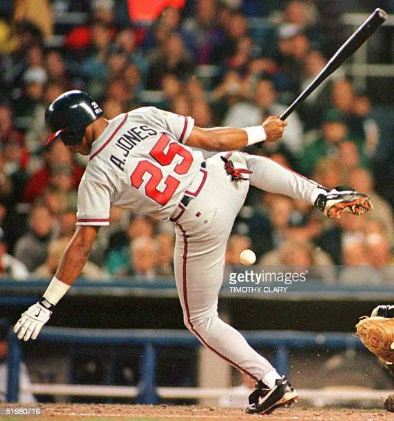 Atlanta Braves player Andruw Jones is hit by a pitch from New York Yankees pitcher Jimmy Key in the second inning of Game Two of the World Series...