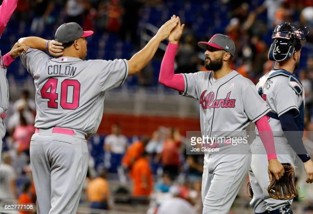 Atlanta Braves players Nick Markakis of the Atlanta Braves and Bartolo Colon of the Atlanta Braves celebrate their 31 win over the Miami Marlins at...