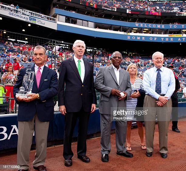 Atlanta Braves President John Schuerholz Chairman and CEO of the Atlanta Braves Terence McGuirk Hall of Famer Hank Aaron and Chairman Emeritus for...