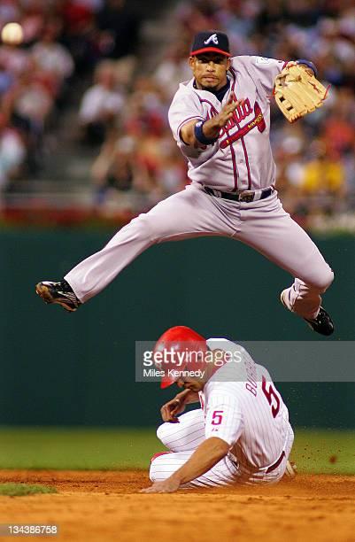 Atlanta Braves Rafael Furcal leaps over Philadelphia Phillies Pat Burrell to complete a double play during the 6th inning Friday July 92004 in...