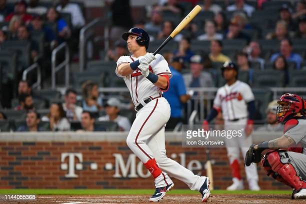 Atlanta Braves rookie outfielder Austin Riley hits his first major league home run in the 4th inning during the game between the Atlanta Braves and...