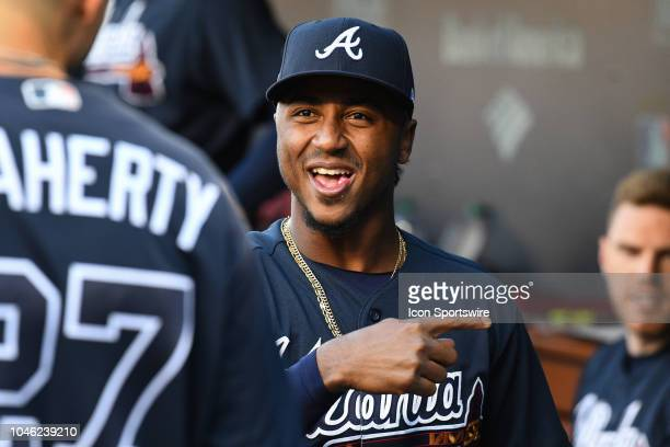 Atlanta Braves second baseman Ozzie Albies jokes with Atlanta Braves infielder Ryan Flaherty in the dugout before Game 1 of the 2018 National League...