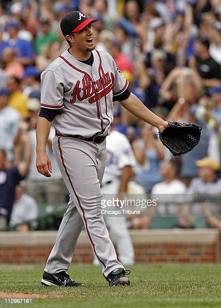 Atlanta Braves starting pitcher Lance Cormier reacts to giving up a solo home run to Chicago Cubs Derrek Lee in the third inning at Wrigley Field in...